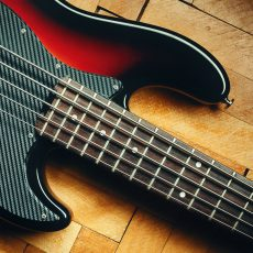 Details of a five strings bass on parquet, classical jazz design.